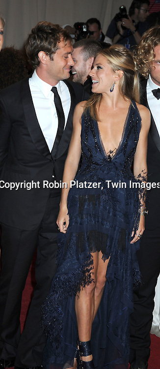 Jude Law and Sienna Miller arriving at The Costume Institute Gala Benefit celebrating American Woman: Fashioning a National Identity at The Metropolitan Museum of Art on May 3, 2010 in New York City.