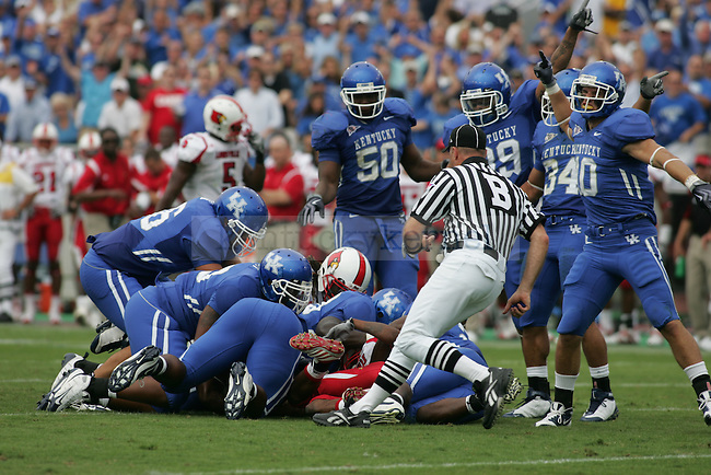 UK secures possession of the ball after Louisville fumbles in the second half of UK's 31-27 win on Saturday Sept. 19, 2009. Photo by Britney McIntosh | Staff.
