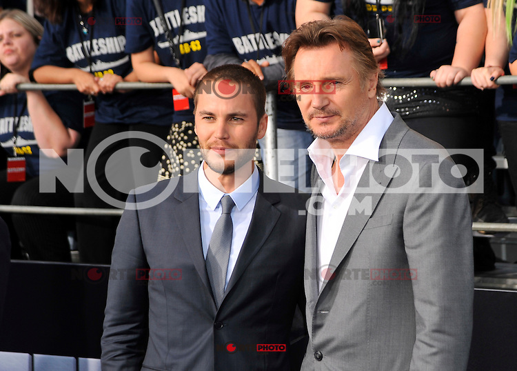 Taylor Kitsch and Liam Neeson at the film premiere of 'Battleship,' at the NOKIA Theatre at L.A. LIVE in Los Angeles, California. May, 10, 2012. © mpi35/MediaPunch Inc.