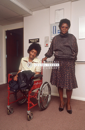 Elderly woman with disability; who is wheelchair user; and friend in residential home,