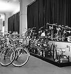 Pittsburgh PA: View of Christmas in store display at Horne's department store in downtown Pittsburgh. Children's steel bicycles, tricycles and wagons on display during the Rhapsody of Steel campaign.  US Steel launched an awareness campaign of all the current uses of steel in everyday products.  During this time, ALCOA Aluminum Company of America also headquartered in Pittsburgh, was aggressively competing to enter markets where US  steel companies traditional dominated market share. Examples included beer and food Cans, appliances, automobile parts, children toys / bicycles, and more.