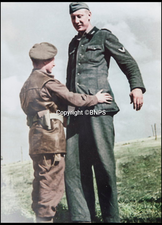 BNPS.co.uk (01202 558833)Pic: TomWren/BNPS<br /> <br /> The moment 5ft 3ins corporal Bob Roberts took the surrender of 7ft 6ins tall Jakob Nacken.<br /> <br /> A D-Day hero who captured the tallest soldier in the German army in a comic David v Goliath moment has been awarded France's top honour 70 years later.<br /> <br /> Corporal Bob Roberts, 92, from Bournemouth, was one of the first troops to step foot on the Normandy beaches and fought throughout France, often leading a charmed life.<br /> <br /> He has now been awarded the Legion d'Honneur by the French government.