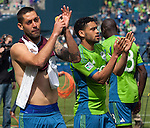 Seattle Sounders Clint Dempsey salutes the fans after their game against the Colorado Rapids during an MLS match on April 26, 2014 in Seattle, Washington.  Dempsey scored twice in the Seattle Sounders 4-1 win over the Colorado Rapids.  Jim Bryant Photo. ©2014. All Rights Reserved.