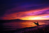 Surfer enjoys a West Maui sunset after surfing at Olowalu, Maui.
