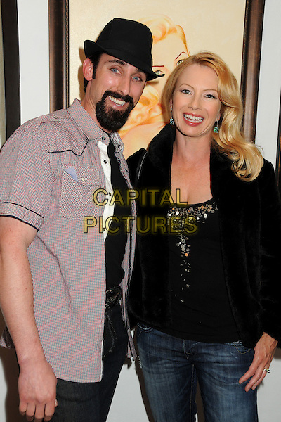 "PAUL J. ALESSI & TRACI LORDS.James Owens ""Savage Beauty"" Art Show Opening Night held at Gasoline Gallery, El Segundo, California, USA>.April 10th, 2010.half length jacket top black silver paillettes tracey hat goatee facial hair pink shirt.CAP/ADM/BP.©Byron Purvis/AdMedia/Capital Pictures."