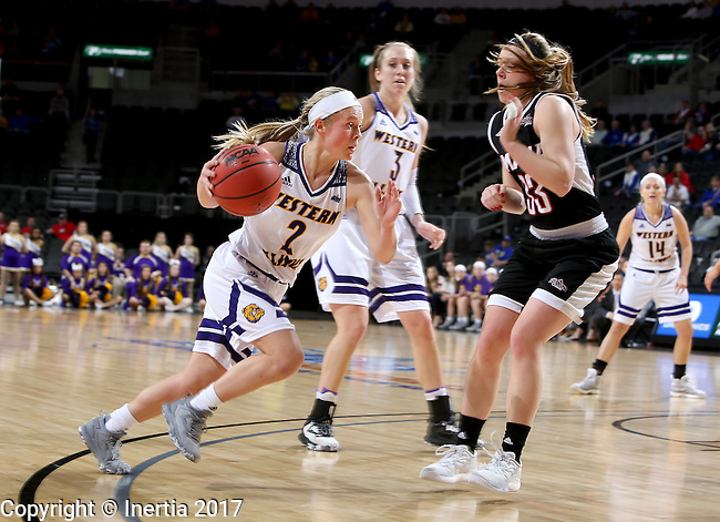 SIOUX FALLS, SD: MARCH 6: Emily Clemens #2 from Western Illinois drives against Remy Davenport #33 from Omaha during the Summit League Basketball Championship on March 6, 2017 at the Denny Sanford Premier Center in Sioux Falls, SD. (Photo by Dave Eggen/Inertia)