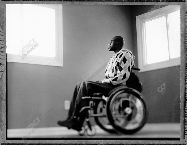 """Army Sergeant Eugene Simpson, wounded in Tikrit, Iraq, visits his new living facilities built by """"Homes for Our Troops"""", a support group for handicapped veterans. Dale City, Virginia, USA, April 2007"""
