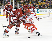 Danny Biega (Harvard - 9), Cason Hohmann (BU - 23) - The Boston University Terriers defeated the Harvard University Crimson 3-1 in the opening round of the 2012 Beanpot on Monday, February 6, 2012, at TD Garden in Boston, Massachusetts.