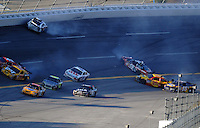 Oct 5, 2008; Talladega, AL, USA; NASCAR Sprint Cup Series drivers Travis Kvapil (28), Carl Edwards (99), Kevin Harvick (29), Michael Waltrip (55), Dave Blaney (22) crash as Kyle Busch (18), Jimmie Johnson (48), Clint Bowyer (07) and David Ragan (6) drive through the scene during the Amp Energy 500 at the Talladega Superspeedway. Mandatory Credit: Mark J. Rebilas-