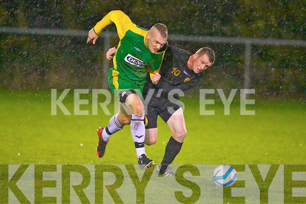 Kerry's Mark O'Sullivan tries to get passed the Defence Forces Gerry Walsh in the Oscar Traynor Cup at Mouthawk park, Tralee on Thursday.