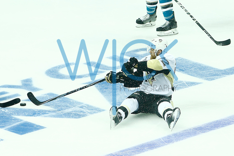 Patric Hornqvist #72 of the Pittsburgh Penguins reaches for the puck from his backside in the second period against the San Jose Sharks during game three of the Stanley Cup Final at the SAP Center in San Jose, California on June 4, 2016. (Photo by Jared Wickerham / DKPS)