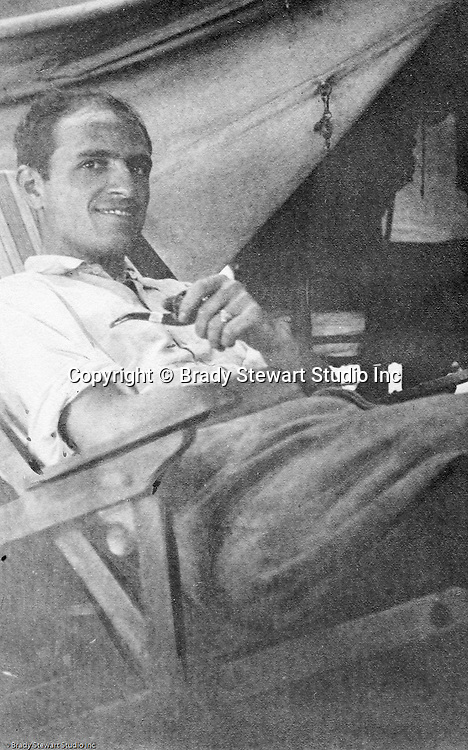 North East PA: View of Brady Stewart relaxing in a chair inside his tent while on vacation.  During the early 1900s, the Stewart family vacationed on Lake Erie near North East Pennsylvania. Since hotels and motels were non-existent, camping was the only viable option for a large number of vacationers