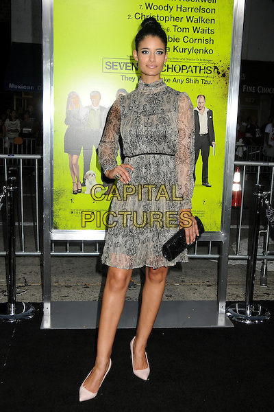 """Jessica Clark.""""Seven Psychopaths"""" Los Angeles Premiere held at the Bruin Theatre, Westwood, California, USA..October 1st, 2012.full length grey gray white black dress hand on hip high collar clutch bag hair up bun shoes.CAP/ADM/BP.©Byron Purvis/AdMedia/Capital Pictures."""