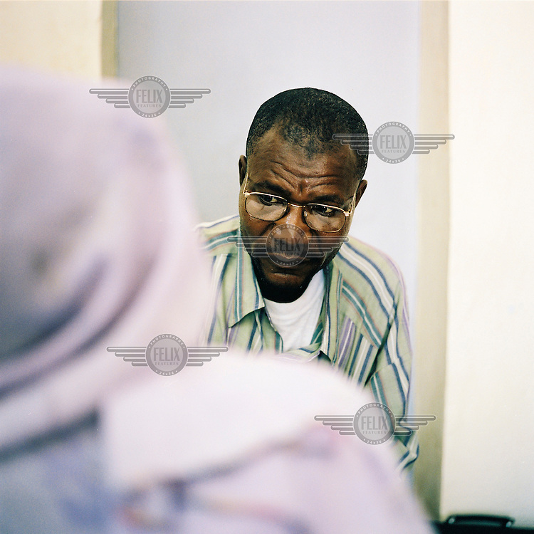 A health worker talks with a recently diagnosed AIDS patient.