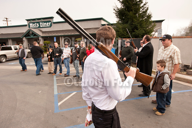 Shotgun-toting locals gather at Mel's Drive-in restaurant to fire off rounds during Jackson, California's Serbian community celebrates Christmas on the Julian Calendar date of January 7.