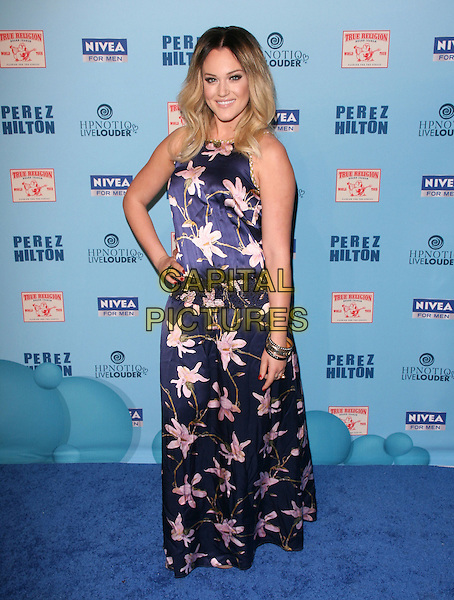 LACEY SCHWIMMER .attends Perez Hilton's Blue Ball held at Siren Studios in West Hollywood, California, March 26th 2011..full length  floral flower print sleeveless hand on hip long maxi dress bracelets avy  blue  .CAP/RKE/DVS.©DVS/RockinExposures/Capital Pictures.