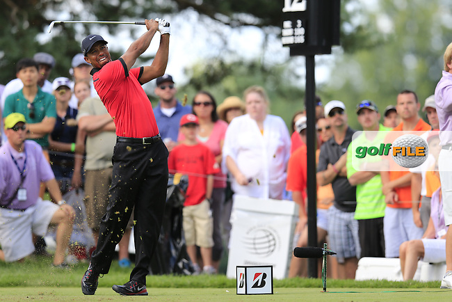 Tiger Woods (USA) tees off the 12th tee during Sunday's Final Round of the 2013 Bridgestone Invitational WGC tournament held at the Firestone Country Club, Akron, Ohio. 4th August 2013.<br /> Picture: Eoin Clarke www.golffile.ie
