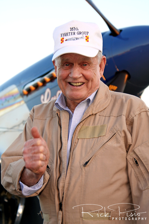 """Clarence """"Bud"""" Anderson gives a thumbs up after piloting TF-51D Mustang """"Lady Jo"""" during a gathering hosted by Dream Machines Inc. at Sacramento Executive Airport on January 30, 2009. Anderson was born on January 13, 1922 in Oakland, California, and earned his wings and commission as a second lieutenant in September 1942. During WWII Bud became a Triple Ace credited with 16 1/4 victories while flying with the 357th Fighter Group in the European Theatre."""