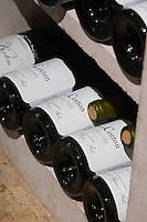 bottles on shelves aloxe corton domaine rapet p & f pernand-vergelesses cote de beaune burgundy france