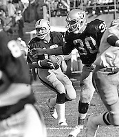 Raiders Jim Plunkett and Mark Van Eeghen against the Chargers. (1980 photo/Ron Riesterer)
