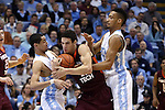 18 January 2015: Virginia Tech's Devin Wilson (center) is tied up by North Carolina's Marcus Paige (left) and J.P. Tokoto (right). The University of North Carolina Tar Heels played the Virginia Tech University Hokies in an NCAA Division I Men's basketball game at the Dean E. Smith Center in Chapel Hill, North Carolina. UNC won the game 68-53.