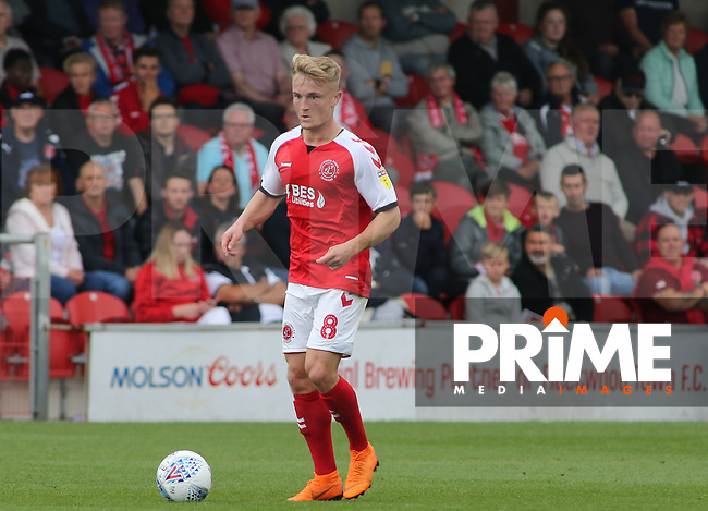 Kyle Dempsey of Fleetwood Town with Molson Coors Official Brewing Patners of Fleetwood Town FC branding during the Sky Bet League 1 match between Fleetwood Town and Rochdale at Highbury Stadium, Fleetwood, England on 18 August 2018. Photo by Stephen Gaunt / PRiME Media Images.