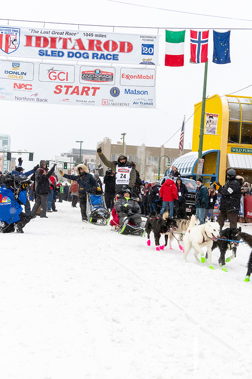 Jeff Deeter and team leave the ceremonial start line with an Iditarider and handler at 4th Avenue and D street in downtown Anchorage, Alaska on Saturday March 7th during the 2020 Iditarod race. Photo copyright by Cathy Hart Photography.com
