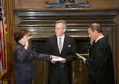 Chief Justice John G. Roberts, Jr., administers the Judicial Oath to Elena Kagan in the West Conference Room of the Supreme Court Building on Saturday, August 7, 2010.   Jeffrey P. Minear, Counselor to the Chief Justice, holds the Bible.  .Mandatory Credit: Franz Jantzen - US Supreme Court via CNP