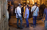 Settlers jews walking armed through streets of Old city of east Jerusalem.