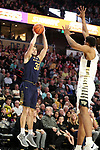 WINSTON-SALEM, NC - FEBRUARY 24: Notre Dame's John Mooney (33) shoots over Wake Forest's Doral Moore (4). The Wake Forest University Demon Deacons hosted the University of Notre Dame Fighting Irish on February 24, 2018 at Lawrence Joel Veterans Memorial Coliseum in Winston-Salem, NC in a Division I men's college basketball game. Notre Dame won the game 76-71.