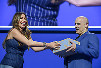 NWA Democrat-Gazette/CHARLIE KAIJO Sofía Vergara hands a box to President and CEO, Walmart eCommerce U.S. Marc Lore during the Walmart shareholders meeting, Friday, June 7, 2019 at the Bud Walton Arena in Fayetteville.