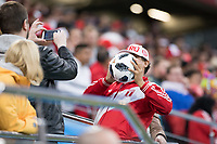 YEKATERINBURG, RUSSIA - June 21, 2018: A Peru fan celebrates getting a soccer ball kicked into the stands during a 2018 FIFA World Cup group stage at Yekaterinburg Arena Stadium between Peru and France.