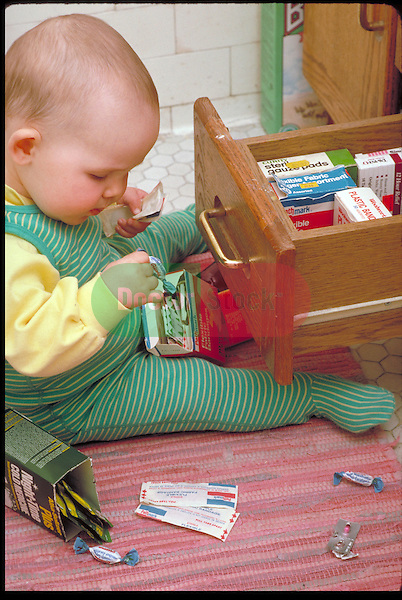 neglected infant girl plays with dangerous medicines in bathroom drawer
