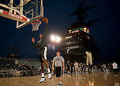 Michigan State University basketball player Adreian Payne dunks during a practice Thursday, November 10, 2011 in the basketball arena on the flight deck aboard Nimitz-class aircraft carrier USS Carl Vinson (CVN 70) in San Diego, California. Carl Vinson is hosting Michigan State University and the University of North Carolina for the inaugural Quicken Loans Carrier Classic basketball game on Veteran's Day, November 11.  United States President Barack Obama and first lady Michelle Obama are scheduled to attend the game..Mandatory Credit: James R. Evans - U.S. Navy via CNP