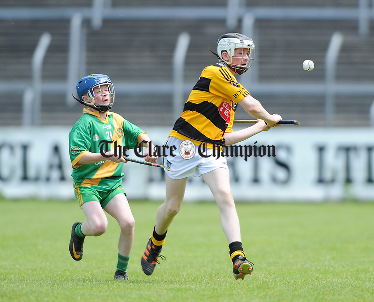 Oran Tracey of Bodyke in action against Henry Mc Grath of O Callaghan's Mills during their U-14C final at Cusack Park. Photograph by John Kelly.
