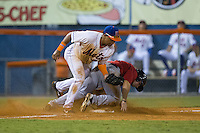 Gregory Valencia (47) of the Kingsport Mets fields a throw as Daniel Kihle (15) of the Elizabethton Twins steals third base in the top of the 11th inning at Hunter Wright Stadium on July 9, 2015 in Kingsport, Tennessee.  The Twins defeated the Mets 9-7 in 11 innings. (Brian Westerholt/Four Seam Images)