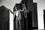 Trombone player Lil' Joe Burton stands on an Atlanta rooftop.