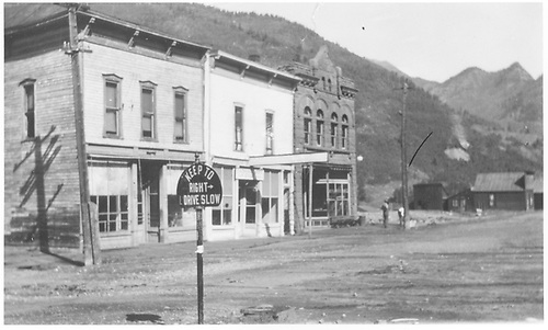 Frontal view of three westside commercial buildings on Glasgow Avenue in Rico including the present day Enterprise Caf? &amp; Lounge.<br /> RGS  Rico, CO