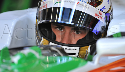 German driver Adrian Sutil of Force India sits in his car in the box during qualifying at Spa-Francorchamps Circuit near Spa, Belgium