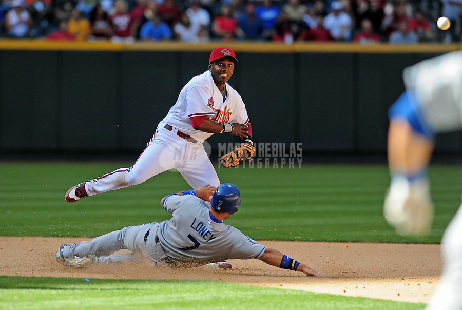 Apr. 9, 2008; Phoenix, AZ, USA; Arizona Diamondbacks second baseman Orlando Hudson throws to first to complete the double play after forcing out Los Angeles Dodgers base runner James Loney in the eighth inning at Chase Field. Mandatory Credit: Mark J. Rebilas-