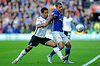Wayne Routledge of Swansea City battles with Lee Peltier of Cardiff City during the Sky Bet Championship match between Cardiff City and Swansea City at the Cardiff City Stadium in Cardiff, Wales, UK. Sunday 12 January 2020