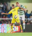 Villarreal's Nahuel holds off Celtic's Breslin .