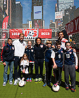 Former men's national team players Tab Ramos, Alexi Lalas, Cobi Jones,and Jimmy Conrad pose with players after a small sided game during the centennial celebration of U. S. Soccer at Times Square in New York, NY, on April 04, 2013.