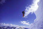 A man jumping while skiing at
