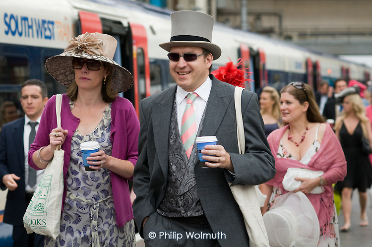 Passengers at Waterloo station prepare to board a train to Ascot racecourse.