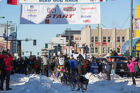Nicolas Petit and team leave the ceremonial start line with an Iditarider and handler at 4th Avenue and D street in downtown Anchorage, Alaska on Saturday March 4th during the 2017 Iditarod race. Photo © 2017 by Brendan Smith/SchultzPhoto.com.