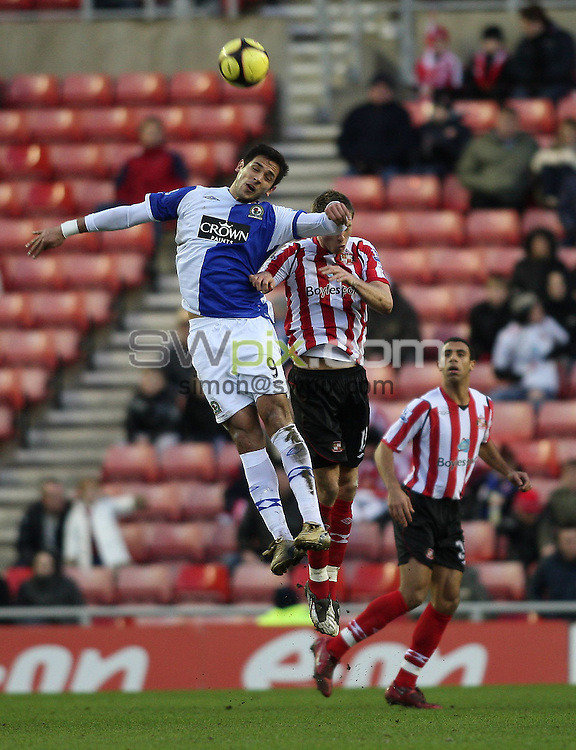 PICTURE BY JEREMY RATA/SWPIX.COM. Barclays Premier League 2008/9 - Sunderland v Blackburn Rovers - Stadium of Light, Sunderland, England. 24th January 2009. Sunderland's Danny Collins is beaten to the ball by Blackburn's Roque Santa Cruz..Copyright - Simon Wilkinson - 07811267706