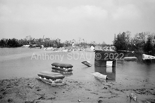 Cameron, Louisianna.USA.September 27, 2005 ..Hurricane Rita damage and recovery in the town of Cameron...The town's cemetery. Coffin's float on the water.