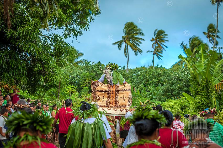 Makirau Haurua being carried on a throne as part of the celebration of his investiture with the Teurukura Ariki title, Aitutaki Island, Cook Islands.