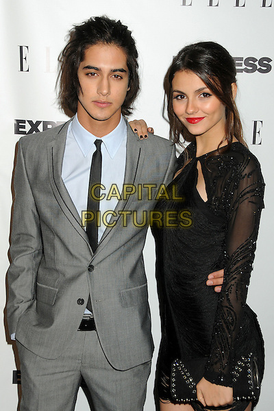 "AVAN JOGIA & VICTORIA JUSTICE.ELLE and Express ""25 at 25"" Event held at Palihouse, West Hollywood, California, USA..October 7th, 2010.half length long sleeve cut out dress grey gray suit tie sheer beaded black clutch bag.CAP/ADM/BP.©Byron Purvis/AdMedia/Capital Pictures."